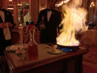 Tableside crêpes being flambéed for our pre-dessert